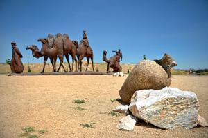 vignette caravane chameaux desert argile  fo
